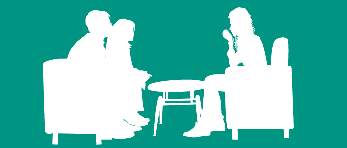 Silhouette of man and woman talking to counsellor